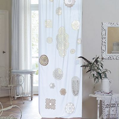 doilies tack-stitched to muslin panels...would be cool in my MB windows...