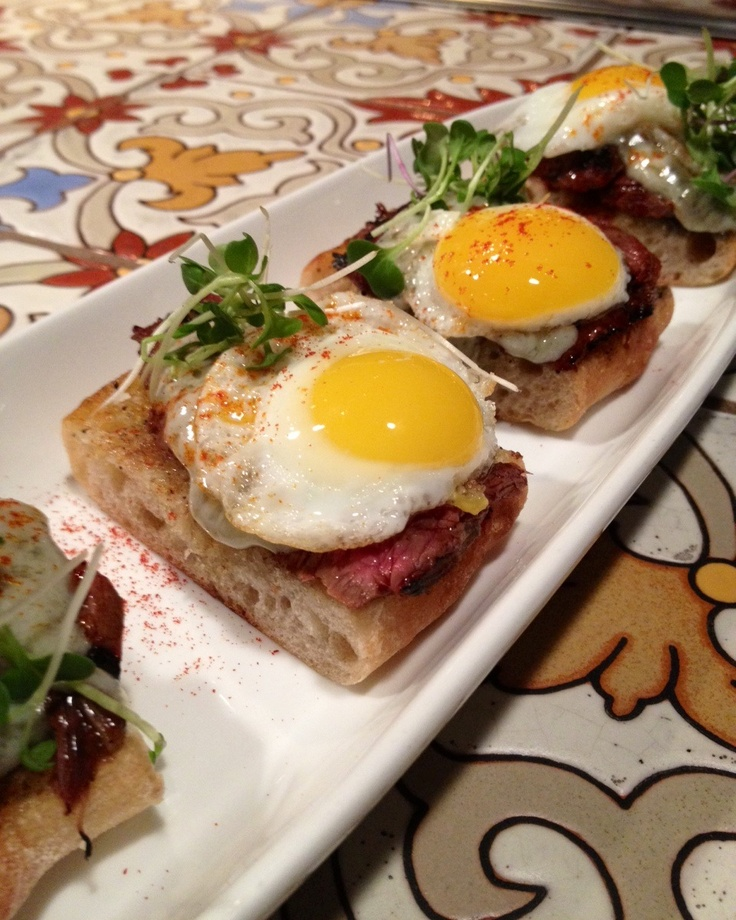 version of steak & eggs. Grilled farm bread, marinated hanger steak ...
