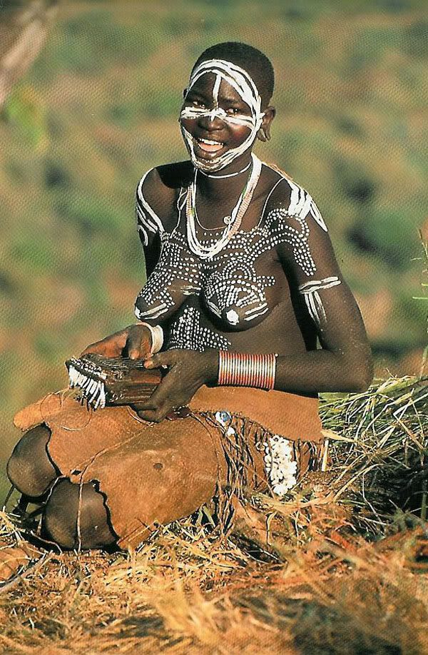 Africa |  Surma woman with painted breasts, Ethiopia |  the work of Carol Beckwith and Angela Fisher in a study of the women of the Horn of Africa, Ethiopia and the surrounding countries