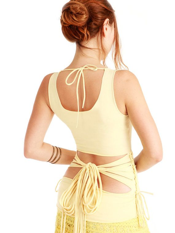 Pale sun yellow women top with an open back and a by Shovava, $49.00