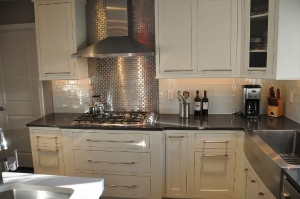 backsplash ivory cream kitchen cabinets cool panel behind the stove