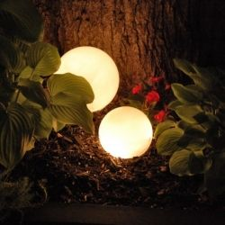 String lights stuffed into Glass Shades - great outdoor lighting.
