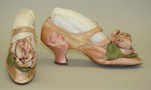 Pink satin shoes with ribbon roses on the toes, by Stern Brothers, 1889.