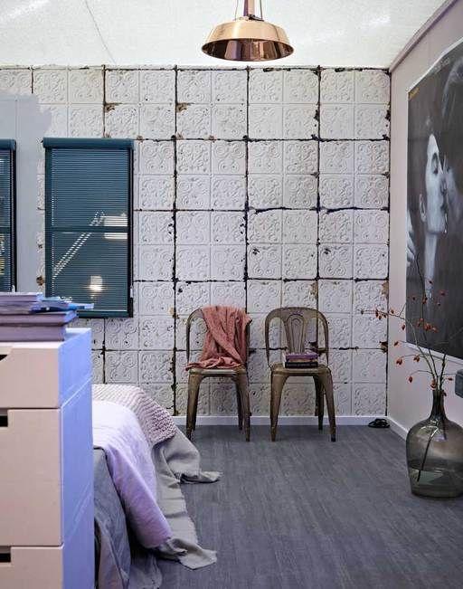 Slapen in stijl doe je in deze prachtige slaapkamer.