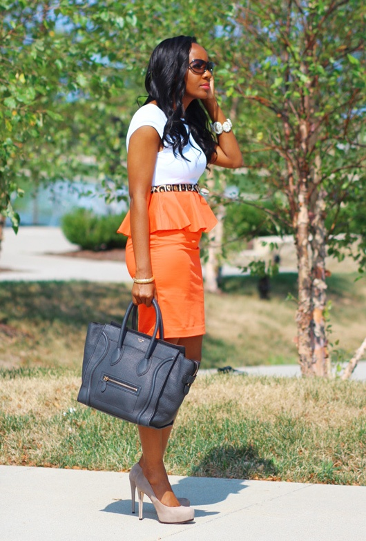Just Patience looks gorgeous in an orange peplum skirt