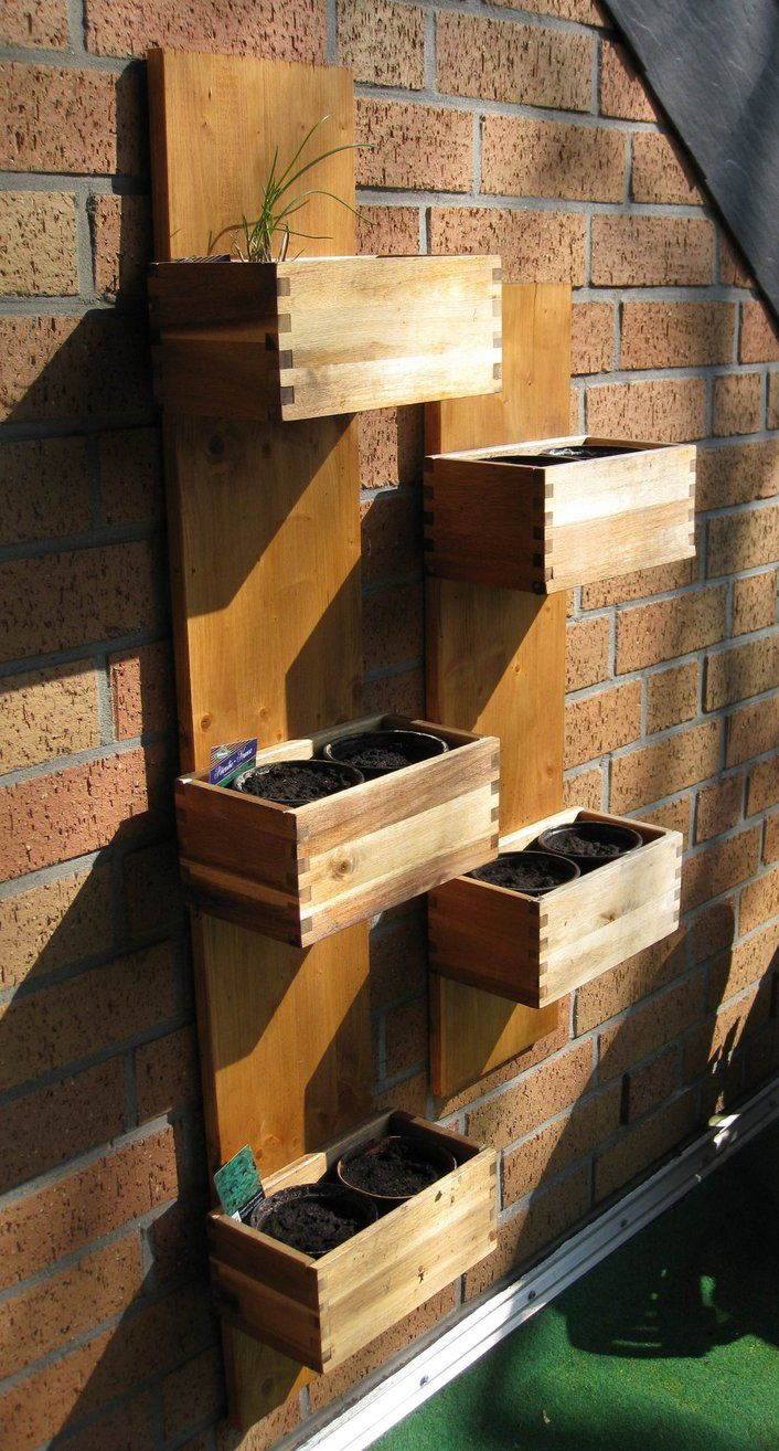 Create a wooden vertical herb garden with Bjurön plant pots from IKEA.