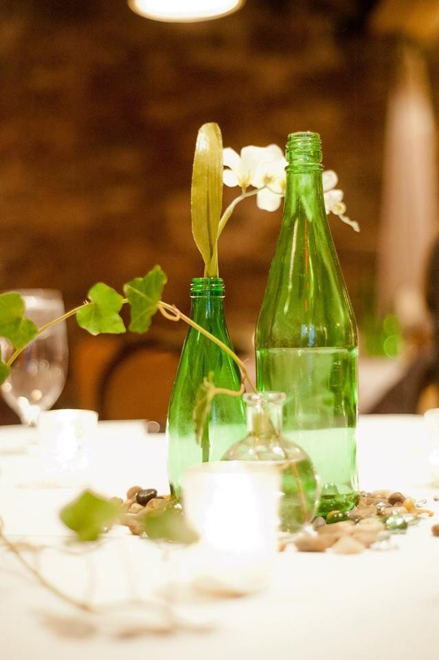 Wine bottle table decorations wedding stuffs pinterest for Wine bottle table centerpieces