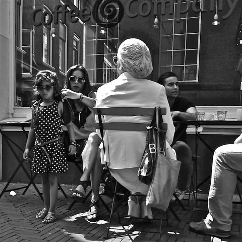 People in The Hague, Netherlands (people candid sunglasses woman child) - a photo by Akbar Sim