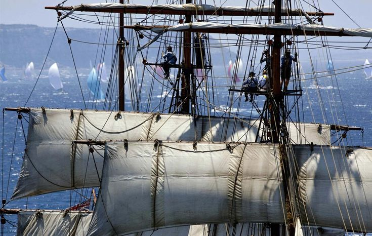 Spectators up the mast on the Tasmanian tall ship James Craig watch the fleet sail out of Sydney Harbour after the start of the 2008 Rolex Sydney to Hobart Yacht race in Sydney, Australia, Friday, Dec. 26, 2008. (AP Photo/ROLEX, Daniel Forster, HO) #