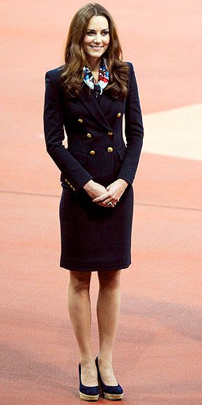 In a sharp navy double-breasted blazer and matching skirt, plus her beloved Stuart Weitzman wedges, the Duchess of Cambridge medals in classic fashion while awarding the gold to Great Britain's Paralympic discus champ Aled Davies.