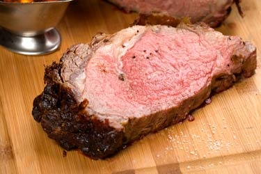 Slow-roasted Prime Rib- served with baked potato and au jus