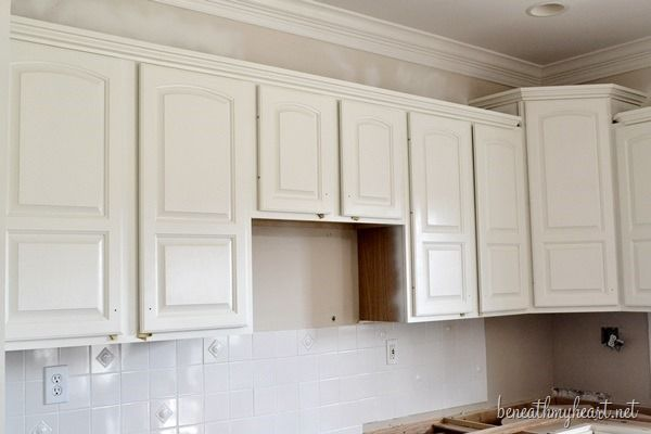 Painting kitchen cabinets white for How to paint your cabinets white