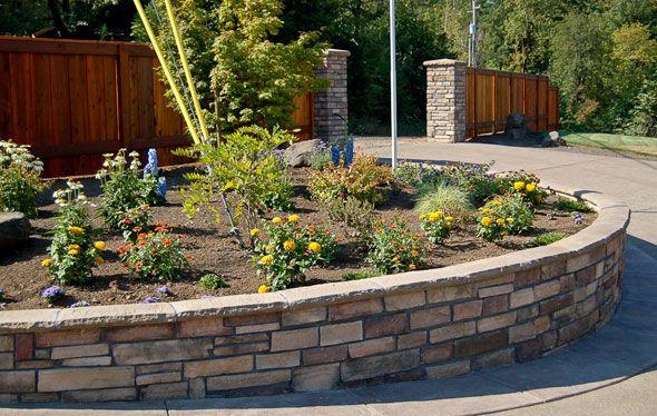 Retaining wall circular planter garden ideas pinterest for Retaining wall plants landscaping