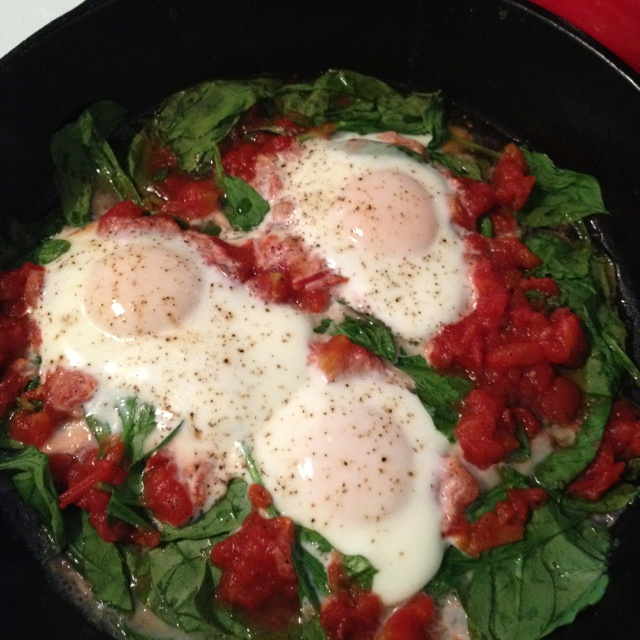 ... (spinach, eggs, roasted tomatoes, olive oil, sea salt, fresh pepper