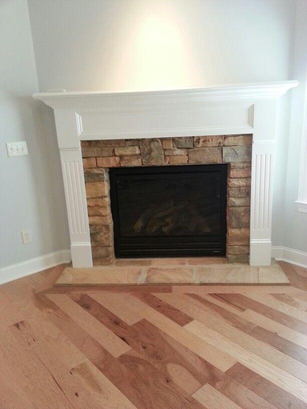 Floor level stone fireplace