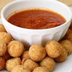 Fried mozzarella balls make a fun addition to your tailgate party.