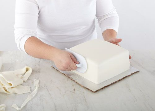 covering dummy cakes with fondant