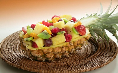 ... fruit salad of some kind :) You can use both half's of the pineapple