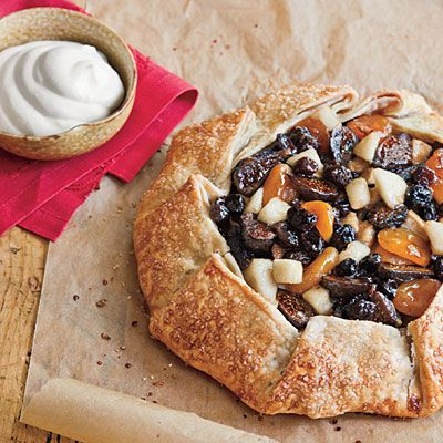 bourbon-soaked spiced pear, apricot, fig, & raisin tart with buttermilk whipped cream. a great fall dessert.