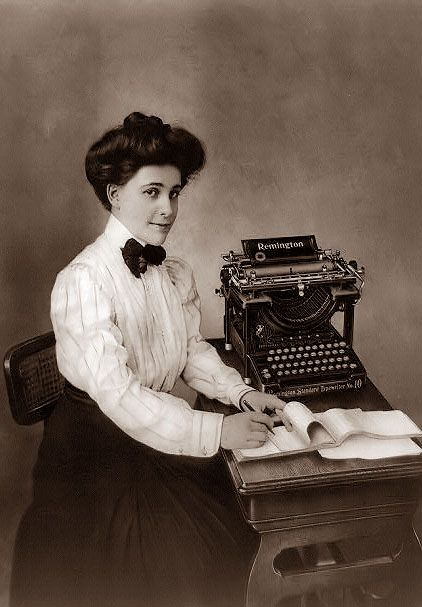 1908, Secretary with typewriter and dictation pad.