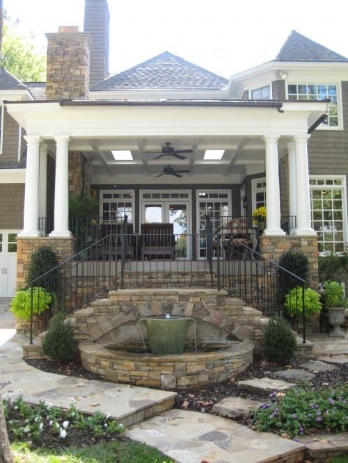 Raised patio, stair idea, stone wall