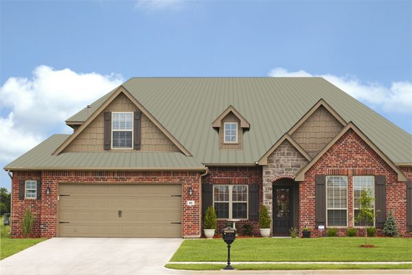Pin by megan gibson on house ideas pinterest for Metal roof pictures brick house
