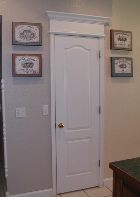 Project cornice of crown moulding over door for Over door decorative molding