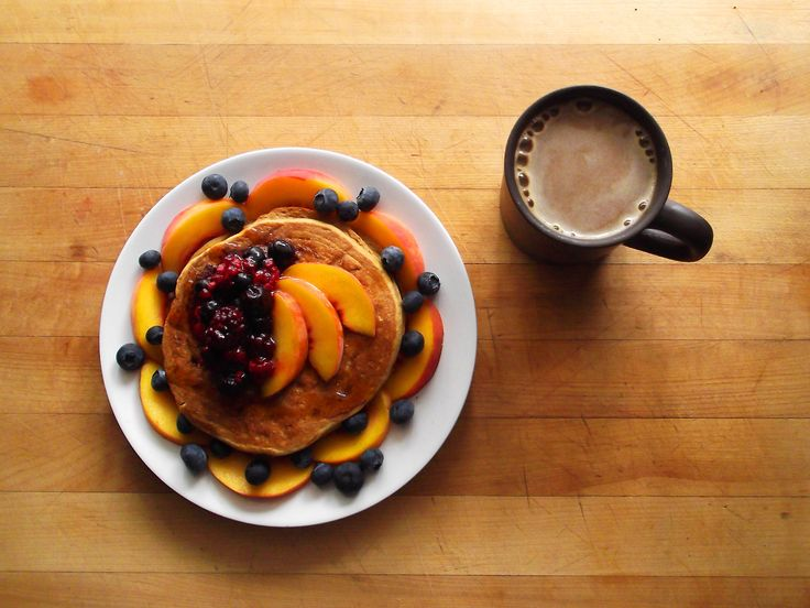 whole wheat pancakes topped with earth balance, sliced peaches, thawed ...