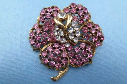 Designer signed WEISS gold tone and pink rhinestone flower brooch