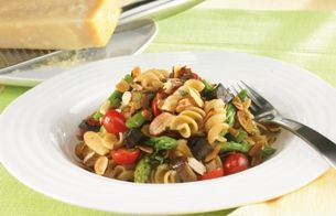 Vegetables and whole wheat pasta with sliced almonds