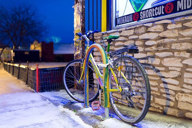 Snow in East Austin. Yarnbomb. Excellent photograph. Layers and layers of subtext. Wow! #yarnbomb #photography #Texas