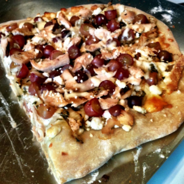 ... and onion, kalamata olive, chicken, rosemary, and goat cheese pizza