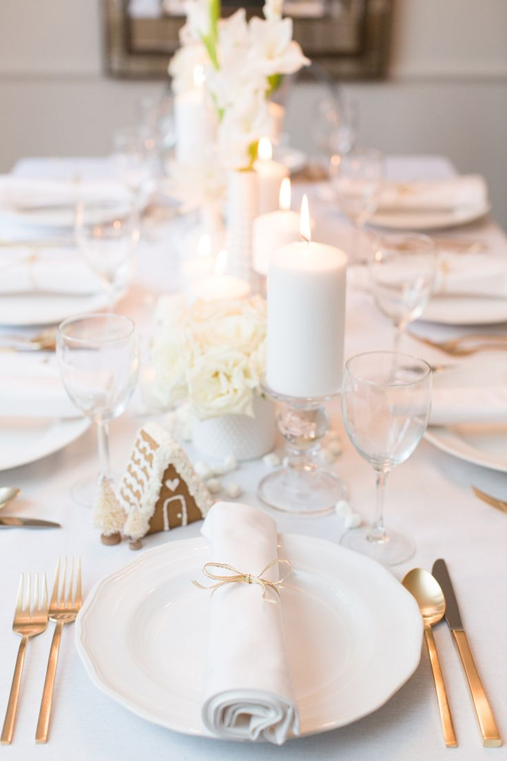 Dreaming of a white Christmas? Use mini gingerbread houses, marshmallows, and white flowers to make this winter wonderland table setting.