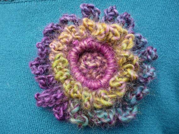 Starburst Crochet Flower Brooch Spring Garden. $20.00, via Etsy.