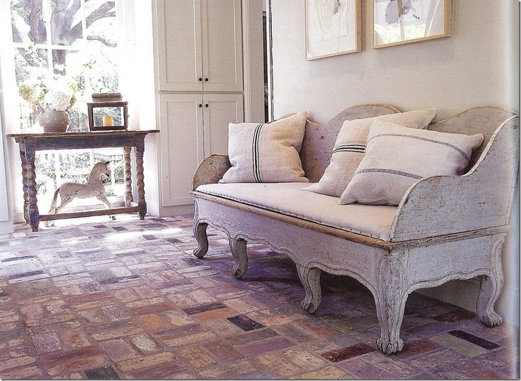 antique swedish sofa with grainsack pillows - love the brick floor