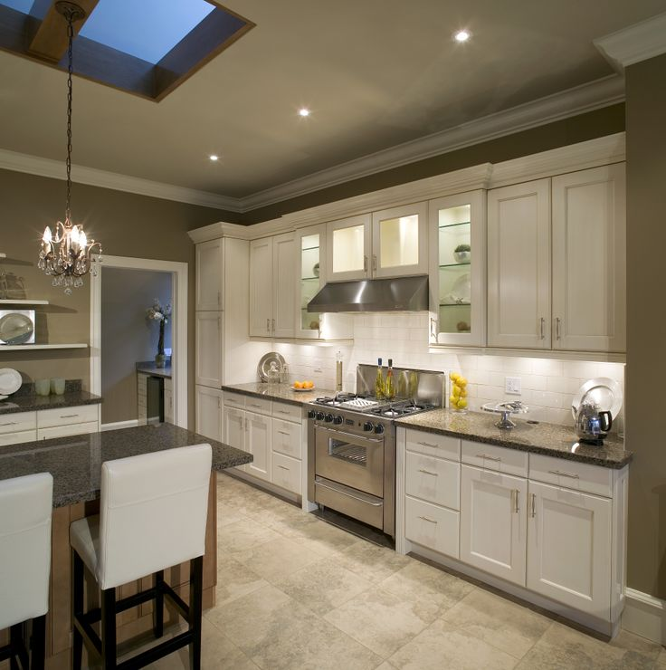 kitchen island with leather bar stools all make this kitchen shine