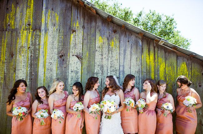 candid bridesmaids and bride shots with vintage barn background  wedding photography