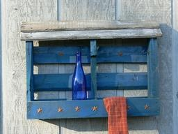 Smaller blue distressed bar/wine rack with slanted roof of distressed pallet wood finished in a dry brush white