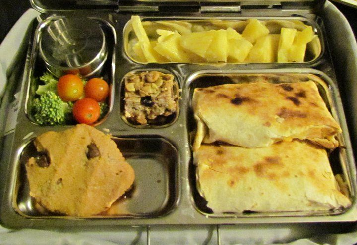 "Cheese ""quesadillas"" folded to fit in the compartment. Pineapple ..."