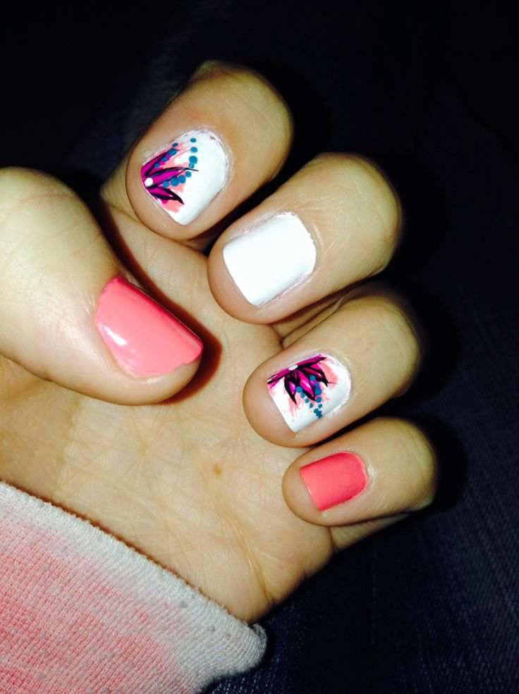 Coral nail design with flowers(: | Taylor