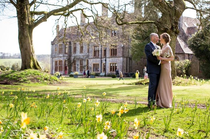 wedding photo with spring daffodils huntsham court country house wedding devon