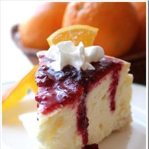 Orange and Almond Cheesecake with Cranberry Sauce