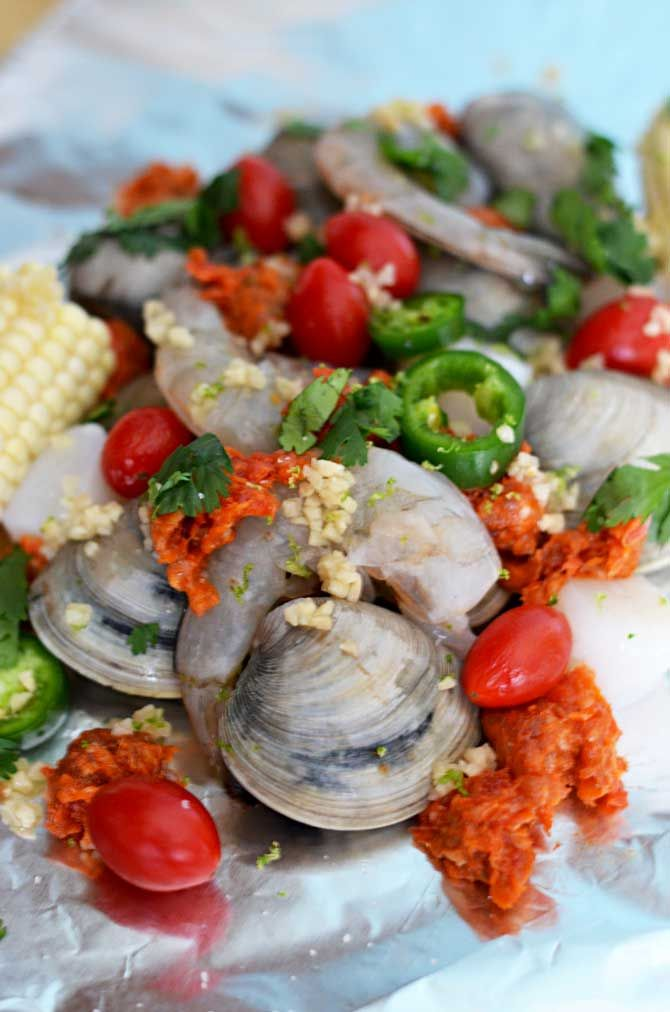 ... with shrimp, clams, scallops, chorizo sausage, corn, and tomato