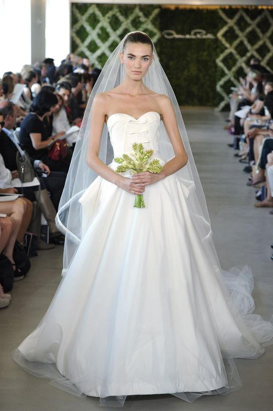 Oscar de la Renta 25, blue nails, bodice, and green flowers.