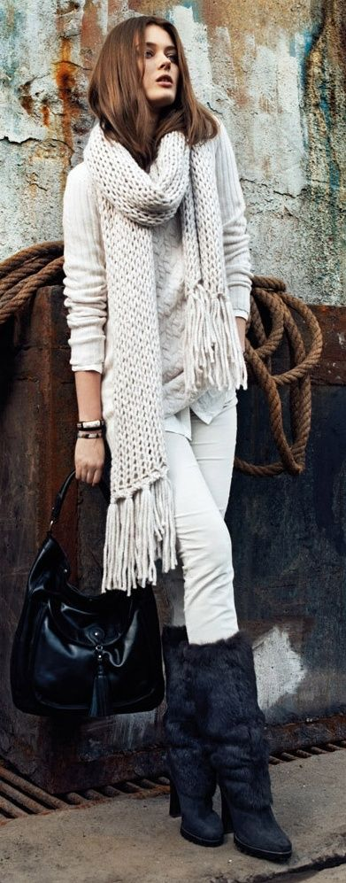 Black leahter handbag white scarf sweater long fur boots