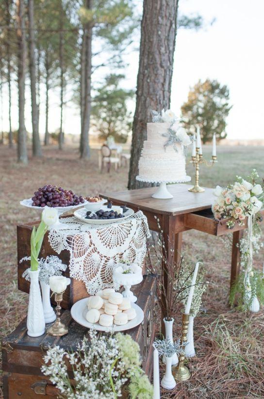 Vintage cake table with florals and treats. #caketable #vintagewedding #weddingchicks Design: River Kiss Weddings ---> http://www.weddingchicks.com/2014/04/28/wedding-ideas-with-some-va-va-voom/