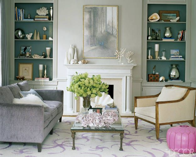 A painting by Loren MacIver is flanked by displays of ceramics, shells, and mercury glass in the living room of Ali Wentworth and George Stephanopoulos.