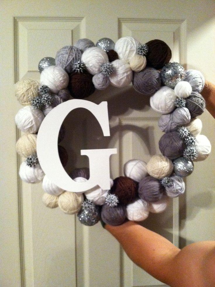 Wreath I made for my husband, Jim, when we were dating. So easy. Wrap the wreath on burlap, wrap foam balls in yarn, spray paint sweet gum balls, paint wooden letter and glue it all together along with ornaments.