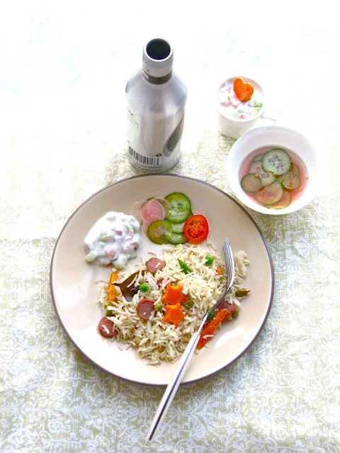 Chicken Pilaf with cucumber tomato raita and relish