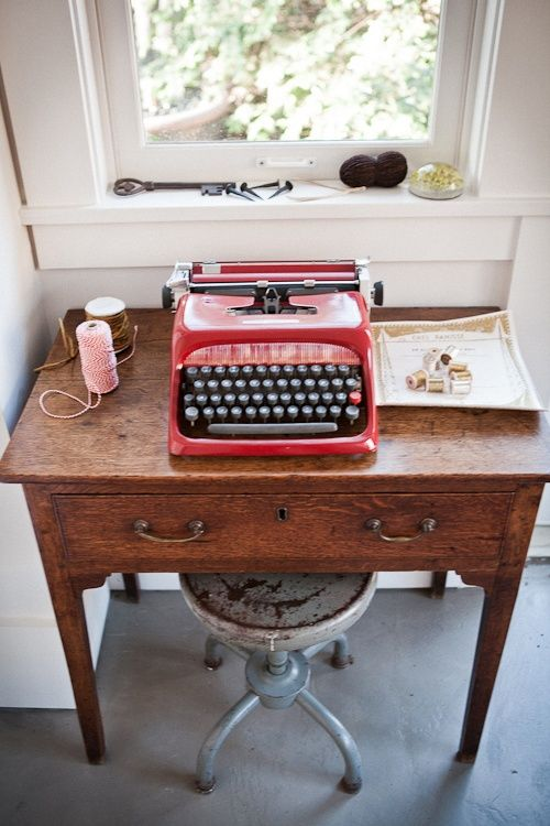 wooden desk with metal stool and red typewriter. I love this desk!!!